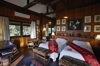 View of the beds in a bungalow La Folie Lodge
