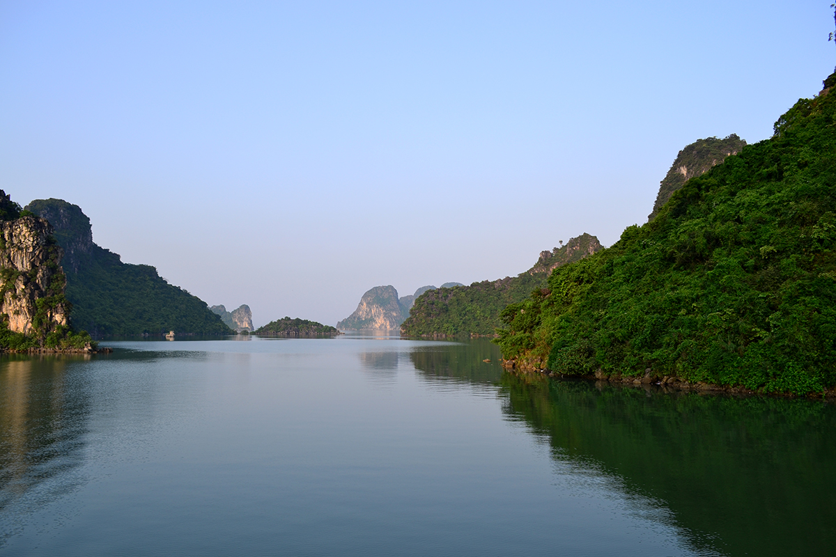Limestone pillars coming out of the water in the Halong Bay