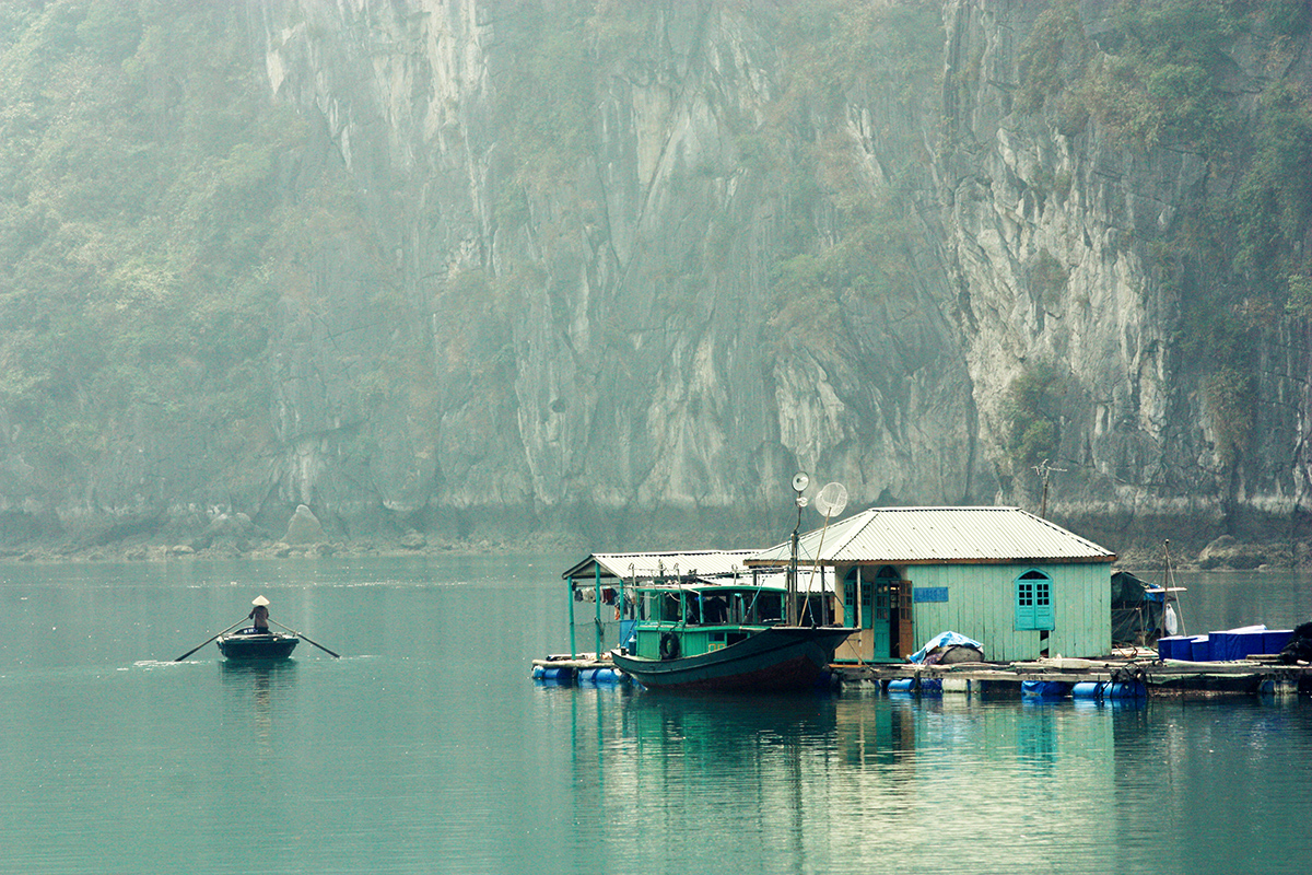 People have to use boats to go around floating villages