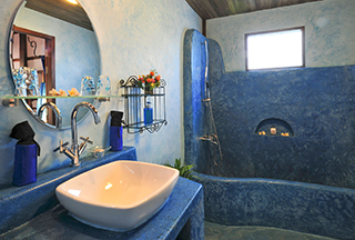 Bathrooms mix wood, granite and stained terrazzo in Muang La