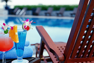 Get a drink at the Poolside Bar